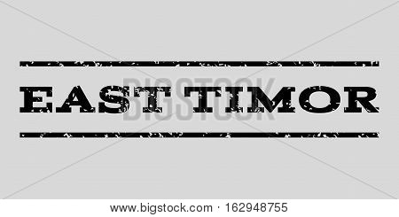 East Timor watermark stamp. Text caption between horizontal parallel lines with grunge design style. Rubber seal stamp with unclean texture. Vector black color ink imprint on a light gray background.