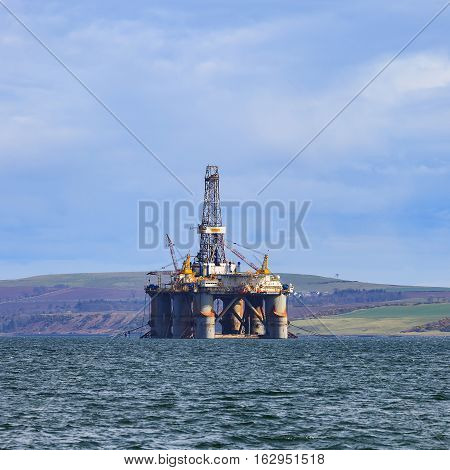 Semi Submersible Oil Rig At Cromarty Firth During Sunset Time In Invergordon, Scotland