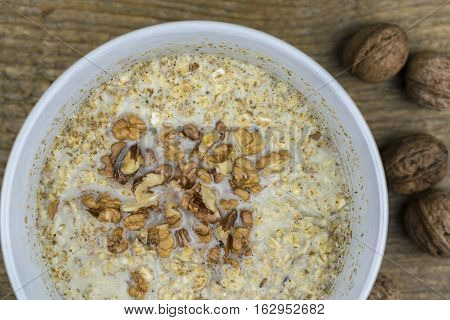 Bowl Of Porridge With Healthy Nuts