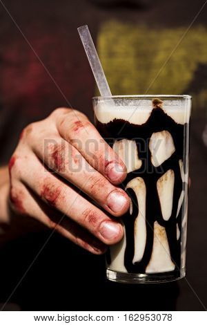 Man With Dirty Fingers Holding A Milkshake