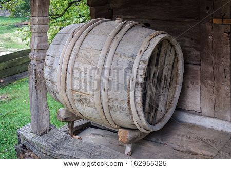 Old wooden wine barrel at the shed in Ukrainian village