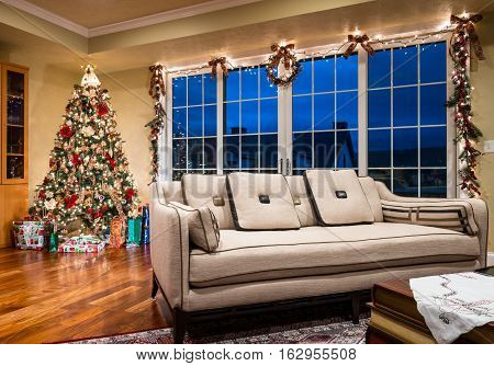 A decorated Xmas tree and gifts neatly arranged around the base ready for a family gathering on Christmas Tree