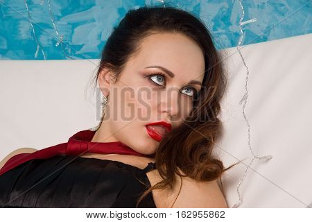 Strangled Beautiful Woman In Black Dress Lies On The Couch