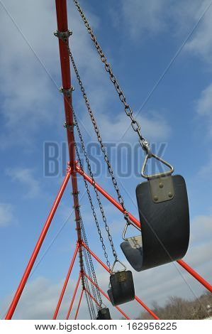 A row of swings at a playground
