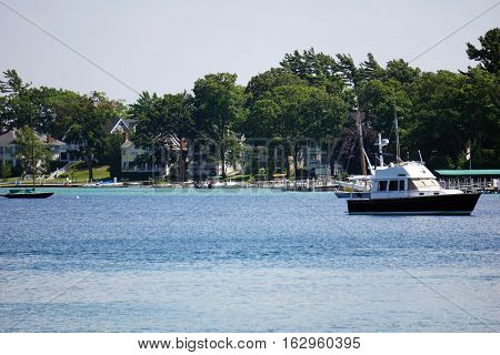 A boat is anchored off the shore of Harbor Point, Michigan during August.