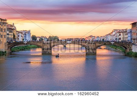 Sunset view of Ponte S. Trinita from Ponte Vecchio in Florence Italy