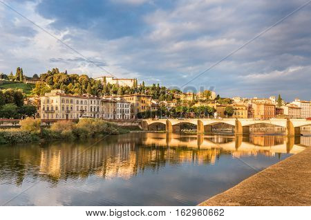View of Ponte alle Grazie on the Arno river with reflections