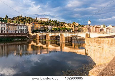 View of Ponte alle Grazie with reflection on Arno river poster