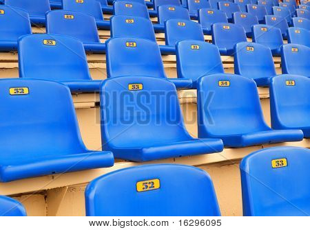 Dark blue seats on a sports tribune