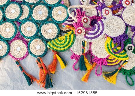 Colorful doormats and coasters made of jute handicrafts on display during the Handicraft Fair in Kolkata earlier Calcutta West Bengal India. It is the biggest handicrafts fair in Asia.