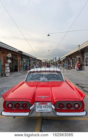 BANGKOK THAILAND - SEPTEMBER 17 2016: Old vintage red car at Night market Srinakarin road that name is train market. This market is open every Wednesday to sunday.