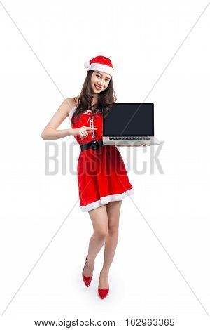 Asian Christmas girl with Santa Claus clothes holding laptop isolated on white background