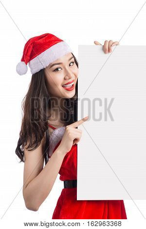 Asian Christmas girl with Santa Claus clothes holding blank sign isolated on white background