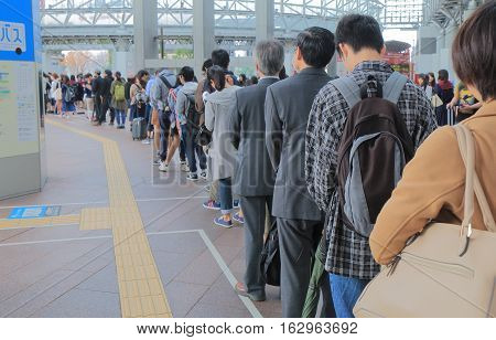KANAZAWA JAPAN - OCTOBER 18, 2016: Unidentified people queue at Kanazawa station bus terminal.