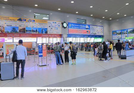 OSAKA JAPAN - OCTOBER 18, 2016, 2016: Unidentified people buy train tickets at Kansai Airport. Kansai International Airport is the main airpot in Kansai region of Japan.