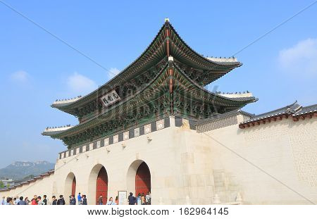 SEOUL SOUTH KOREA - OCTOBER 19, 2016: Unidentified people visit Gwanghwamun Gate in Seoul. Gwanghwamun Gate is the main and largest gate of Gyeongbokgung Palace