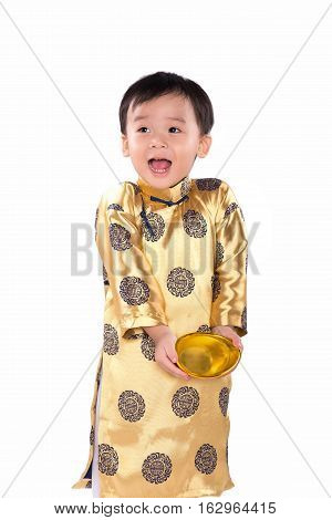 Funny Little Vietnamese boy holding gold symbol or Tet. Asian kid holding red packet, vietnamese new year theme. Character on the red pack symbolizes coming of lunar new year.
