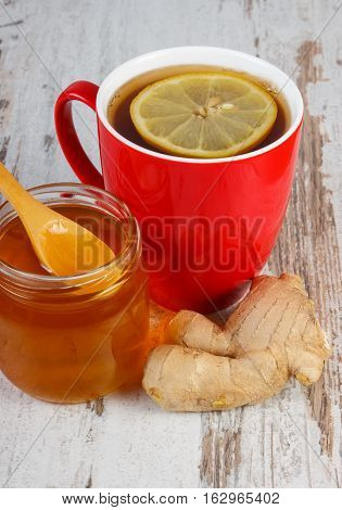 Honey, Ginger And Cup Of Tea With Lemon On Wooden Table, Healthy Nutrition