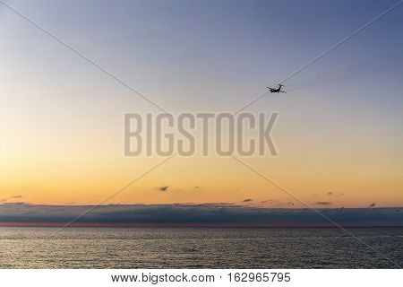 plane flies over the sea from the airport in Adler Sochi