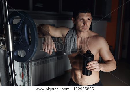 Guy Bodybuilder Tired In Gym Hold Shaker With Sportive Nutrition - Protein Of Shaker.