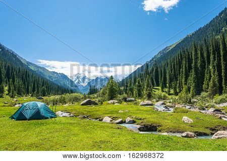 Blue Tent On The Banks Of Mountain Rivers, Kyrgyzstan.