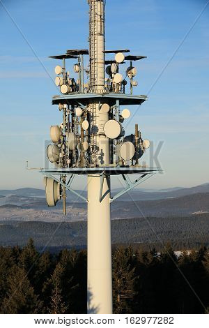 Telecommunications tower with parabolic. Sunny day in Bavaria.