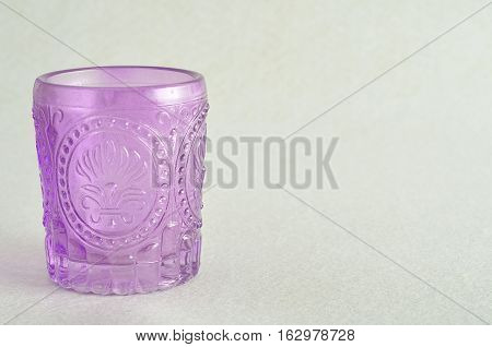 A small fancy glass vase isolated against a white background