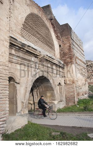 Iznik, Turkey - February 4, 2007: a man cycling in Roman Castle in Iznik (Nicea), Bursa