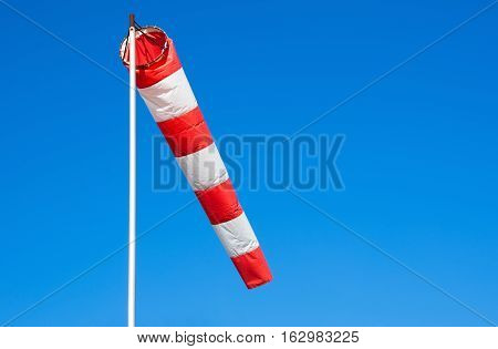 Airport windsock on clear blue sky background.  Air sock, drogue, wind sleeve, wind cone