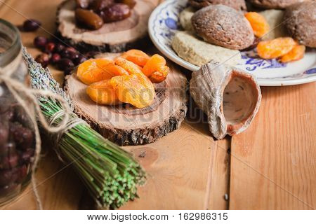 the composition of the traditional winter ingredients - dried fruits, pastries, rosehip seed tea, bundle of lavender and shell