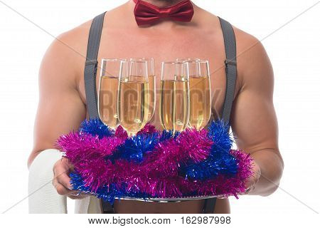two glasses of champagne on the background of beautiful muscular body waiter