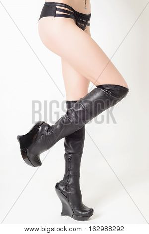Shapely Female Legs In Fashionable High Black Leather Boots