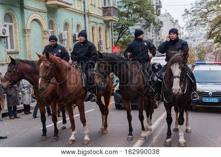 Kiev Ukraine - October 14 2016: Mounted police on city street protect law and order during the procession in honor of Defender of the Fatherland Day