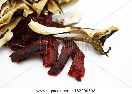 Pictures of dry red pepper and aubergine cup on the most beautiful and best white background