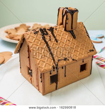Homemade gingerbread house whit caramel on white background