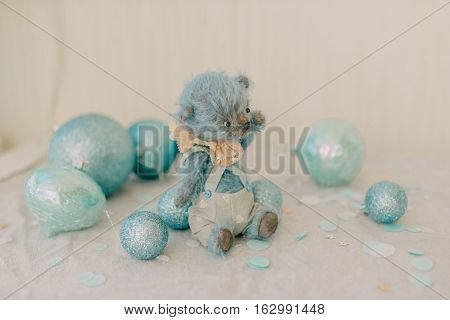 blue on a white background bear with Christmas toys blue balls