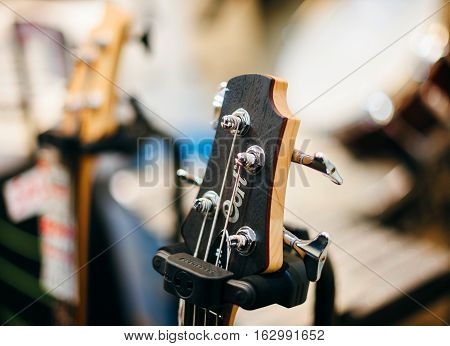STRASBOURG FRANCE - DEC 20 2016: New Cort Guitar head with white price tag