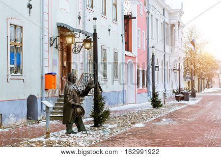 Artist Johann Voldemar Jannsen (1819-1890) memorial. Architectural diversity in centre of resort Estonian town Parnu. Snow-covered streets of tourist Baltic city in winter