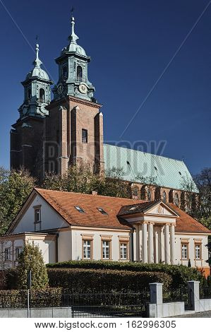 Neoclassical house and towers of the Basilica Archdiocese of Gniezno