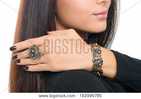 studio portrait model wearing stylish finger ring and bracelet. Spring accessory and jewelry collection