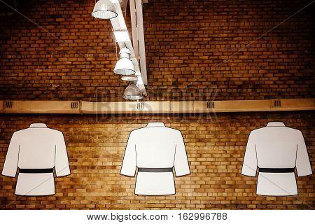 white kimono hanging on wall of hall of fame judo