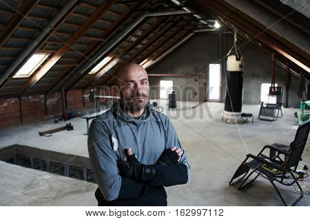 Portrait sportsman boxer in a makeshift home gym