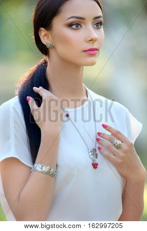 long hair beautiful woman. Model with luxury accessory and jewelry. Close-up beauty portrait outdoor