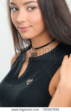 Fashion model beautiful woman demonstrated spring collection luxury accessory and jewelry. Stylish choker on girl neck
