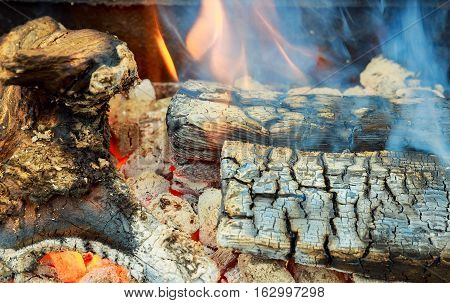 Closeup Of Firewood Burning In Fire Three  Billets In Hot Stove