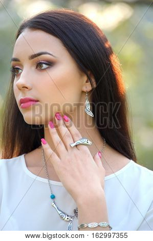 close-up portrait fashion model with luxury accessory. Close-up beauty portrait with jewelry outdoors