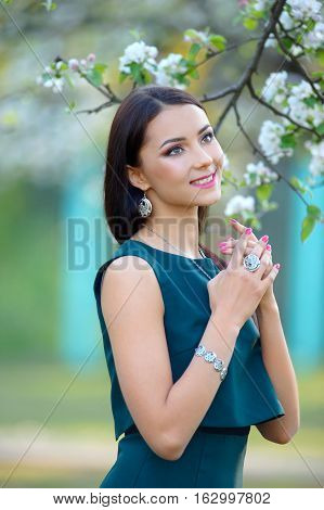 beautiful long hair model demonstrated spring collection beauty accessory and jewelry at spring blooming garden