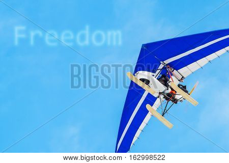 The Motorized Hang Glider In The Blue Sky. Freedom, Success, Vacation, Business Concepts