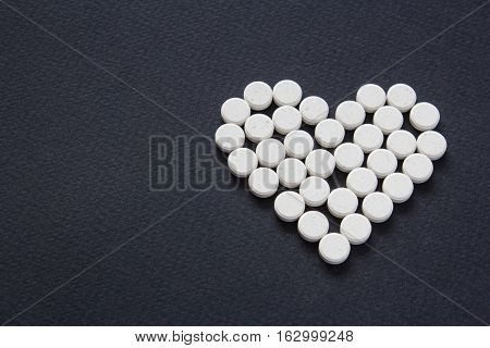 Meny different white pills. Medicine background from much capsules and pills. Drugstore set. Medicine Pills. heart