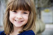 Portrait of a pretty little girl with bright smile poster